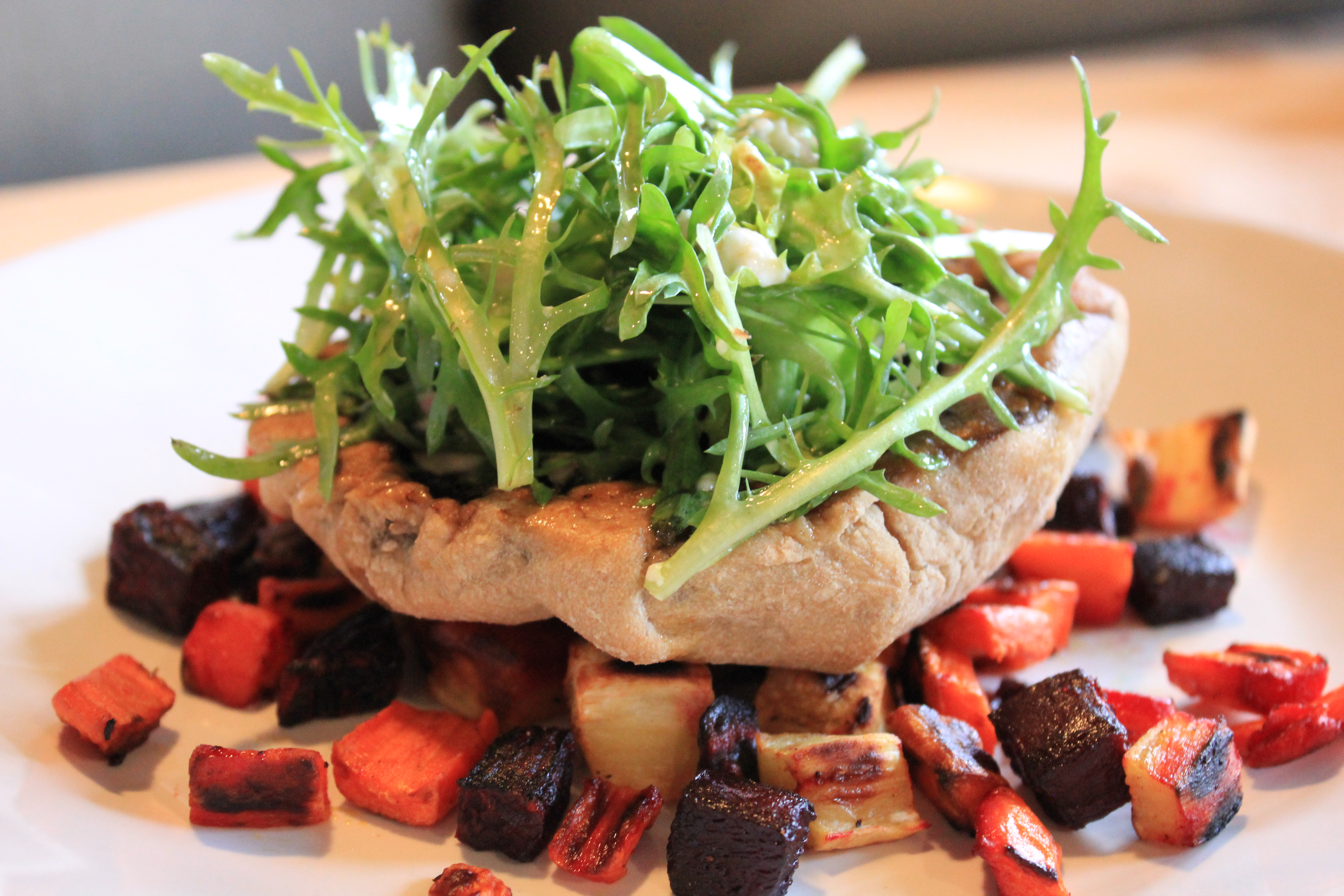 ... Root Vegetables topped with Baked Portobello Mushroom and Frisee